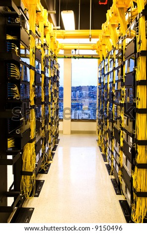A shot of network cables and servers in a technology data center - stock photo