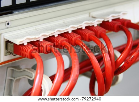 A shot of network cables in Data Center. UTP cables connected to a Patch Panel. Data Network Hardware Concept. RJ45 connectors. - stock photo