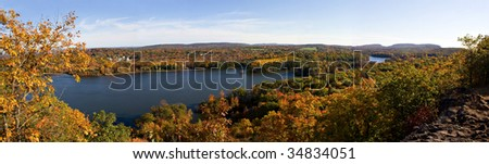 A shot of New England during early autumn foliage at its peak colors. - stock photo