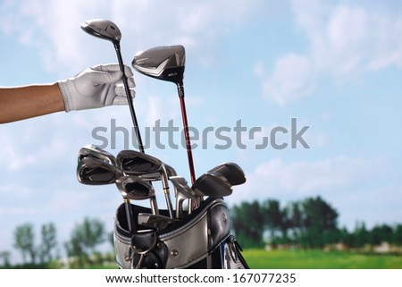 A shot of Removing golf club from bag - stock photo