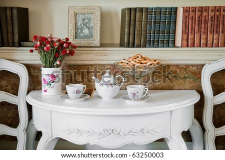 A shot of romantic dinner table in luxury home - stock photo