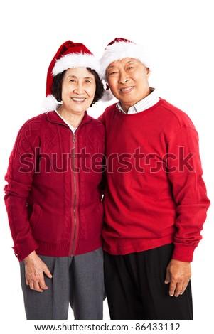A shot of senior Asian couple celebrating Christmas - stock photo