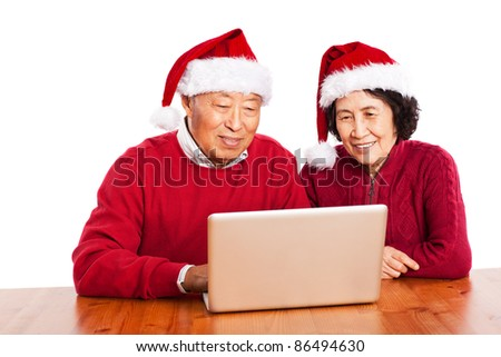 A shot of senior Asian grandparents using computer - stock photo