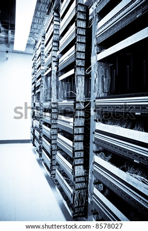 A shot of servers and hardware in an internet data center - stock photo