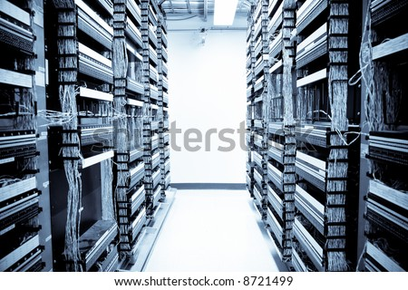 A shot of servers and hardwares in an internet data center - stock photo