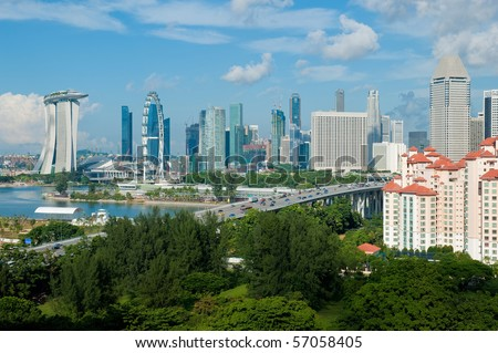 A shot of Singapore skyline including the Flyer and new integrated resort at Marina Bay - stock photo