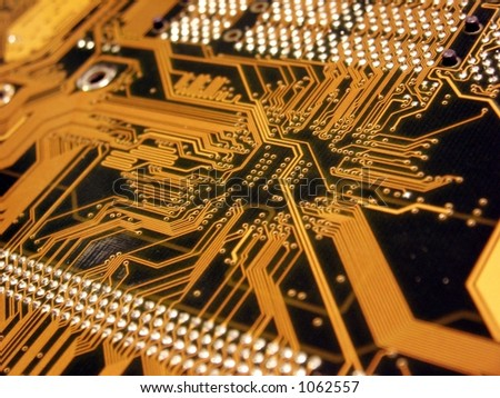 A shot of the back side of a new dual processor computer mother board.  This image is a nice background image for print material related to computer technology. - stock photo