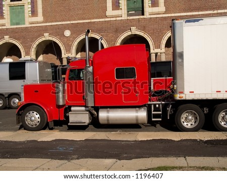 A shot of the cab of a colorful red truck. - stock photo