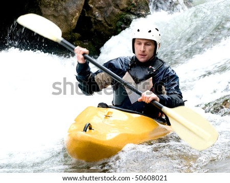 a shot of the kayaker with an oar on the water - stock photo