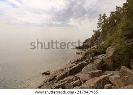 A shot of the Lake Superior coastline at dusk.  Shot in Lake Superior Provincial Park, located in Ontario, Canada.   - stock photo