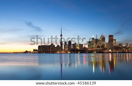 A shot of the Toronto skyline during sunset from across the lake - stock photo