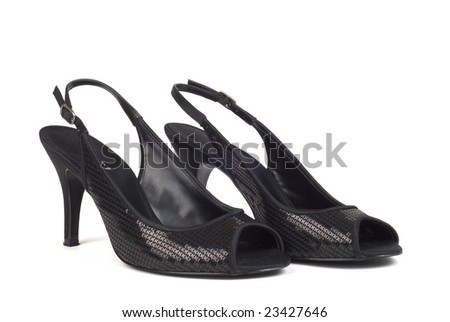 A shot of two black women's high-heel dress shoes against white background - stock photo