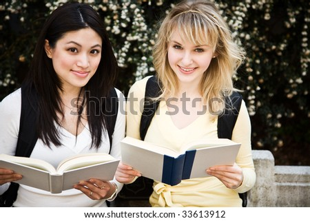 A shot of two college students having a discussion on campus - stock photo