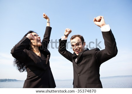 A shot of two happy business colleagues celebrating outdoor