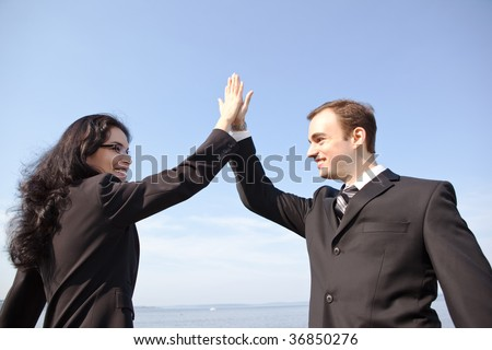 A shot of two happy business colleagues celebrating outdoor - stock photo