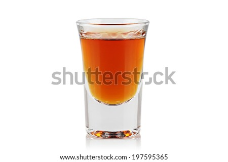 A shot of whiskey on a white background. - stock photo