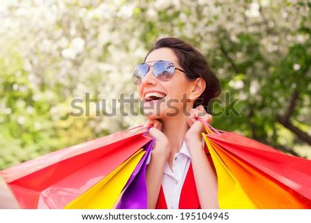 A shot of woman shopping outdoor - stock photo
