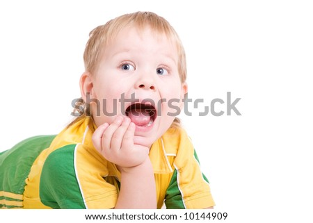 a shouting boy lays on the floor with the open mouth