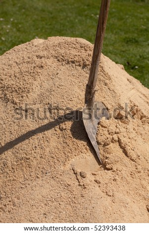 A shovel in a sand - stock photo