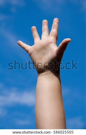a show of hands of a childs hand - stock photo