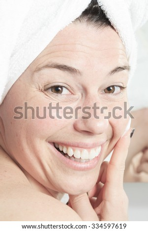 A Shower woman. Happy smiling woman washing shoulder showering in bathroom. - stock photo