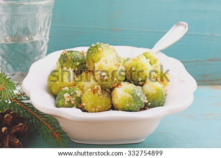 a side dish of brussels sprouts with nuts - stock photo