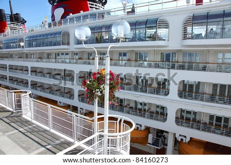 A side view of a cruise ship at Canada Place in Vancouver BC Canada. - stock photo