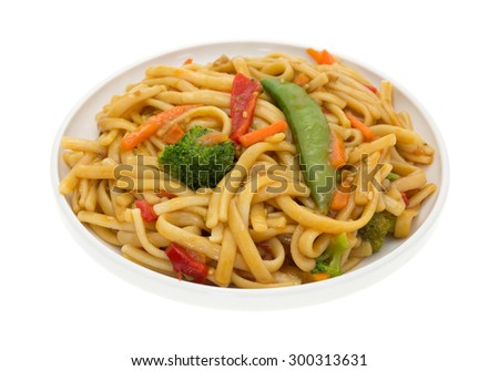 A side view of a delicious  noodles with broccoli, carrots, red pepper slices in dish on a white background.  - stock photo