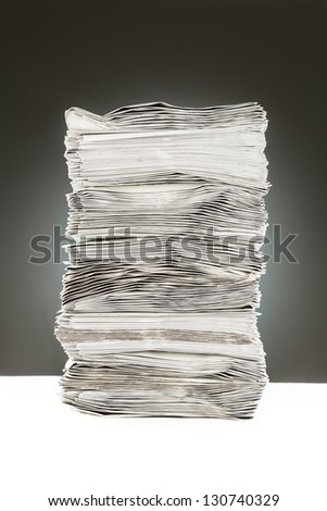 A side view of a pile of papers - stock photo
