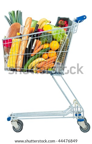 A side view of a shopping cart full of groceries on a white background - stock photo