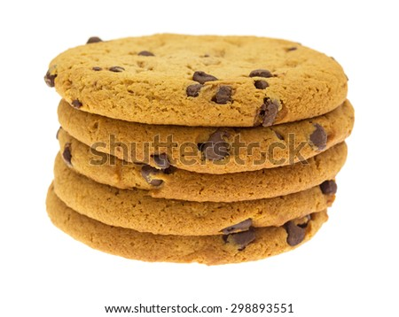 A side view of a stack of five chocolate chip cookies on a white background. - stock photo