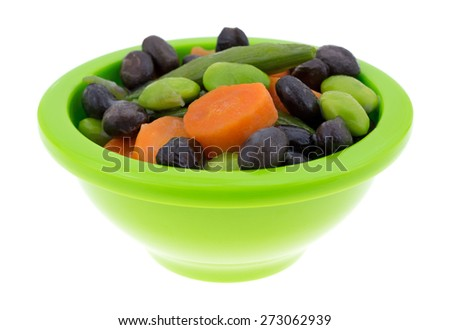 A side view of assorted vegetables in a butter sauce. - stock photo