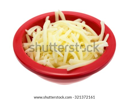 A side view of natural white shredded mild cheese in a red bowl. - stock photo