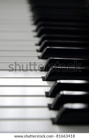 A side view of some piano keys - stock photo