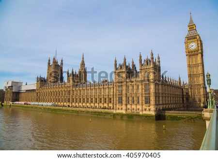 A side view of the Palace of Westminster in London during the day. There is space for text - stock photo