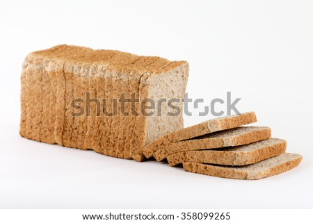 A sideview from a bread for toasting completely sliced and stacked isolated on a white background. - stock photo