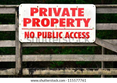 "A sigh on a fence reads: ""PRIVATE PROPERTY - NO PUBLIC ACCESS""."