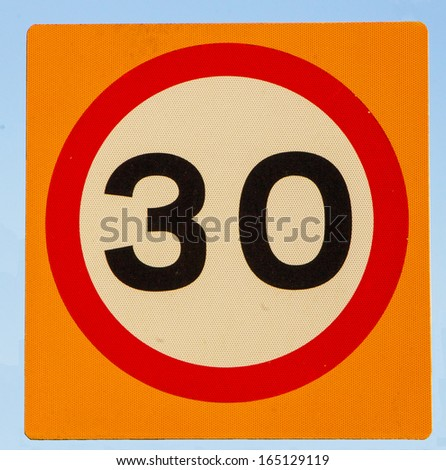 A 30 sign, a speed limit or other 30 limit concept - stock photo