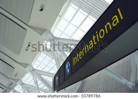 A sign above the international departure gate at a new terminal in a major North American airport. - stock photo