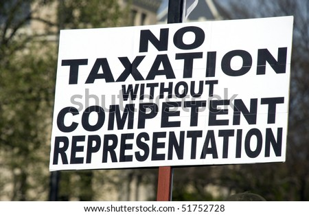 a sign at a tea party rally protesting USA tax laws - stock photo