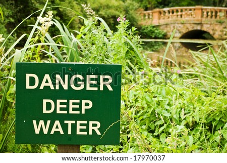 A sign clearly spells out the dangers in this idyllic location - stock photo