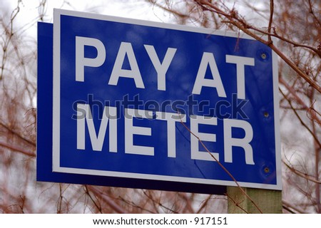 A sign extolling car-drivers to pay for their car-parking at the meter.