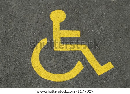 A sign for disabled parking, on asphalt. - stock photo