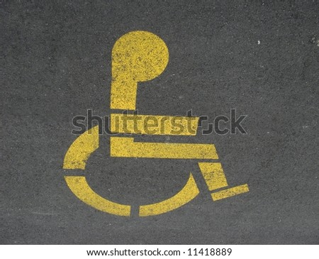 A sign for disabled parking, on asphalt (from New Zealand) - stock photo