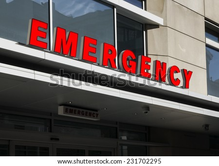 a sign for the emergency room at a hospital - stock photo