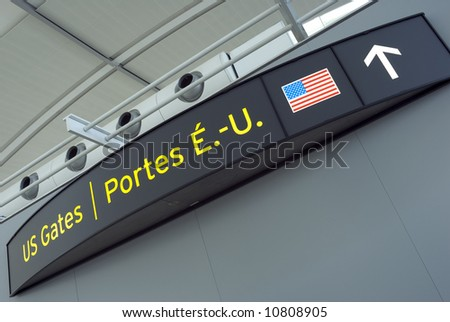 A sign, in English and French, to US Gates at a new terminal in a major North American airport.