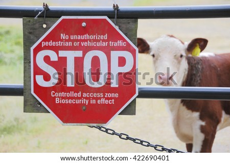 A sign is posted in an attempt to keep germs and disease infecting farm animals/Bio Security or Biosecurity and Farm Animals/A sign is posted to keep germs and disease infecting farm animals.