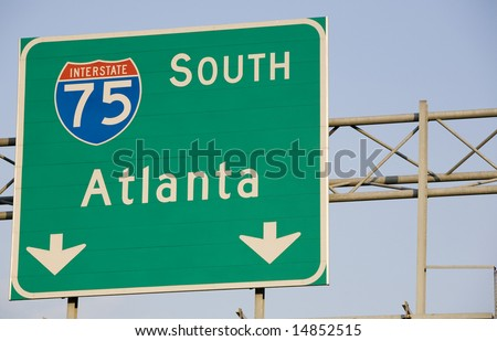 A sign marking the Interstate 75 south route to Atlanta, Georgia. - stock photo