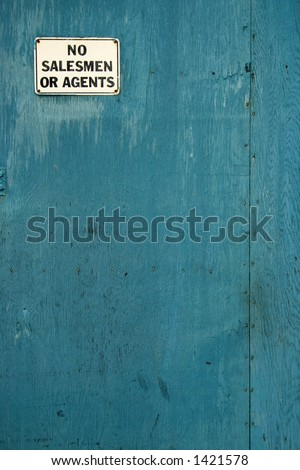 A sign on a blue door. - stock photo