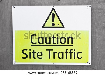A sign on a building site warning of site traffic - stock photo